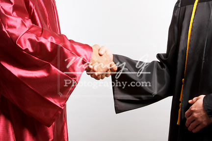 A Dean shaking hands with a graduate