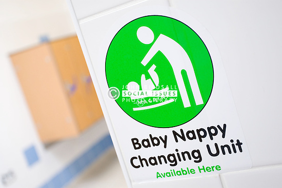 Sign for baby nappy changing unit at sports leisure centre,