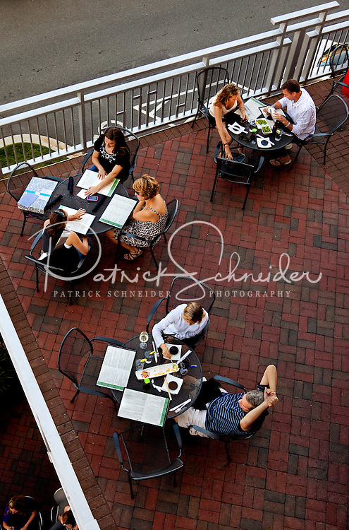 Visitors enjoy an evening in the retail shopping center, Ballantyne Village. The Ballantyne Village is located in Ballantyne, a suburban community of Charlotte NC, near the South Carolina border. The 2,000-acre mixed-use development was created by land developer Howard C. Smokey Bissell.