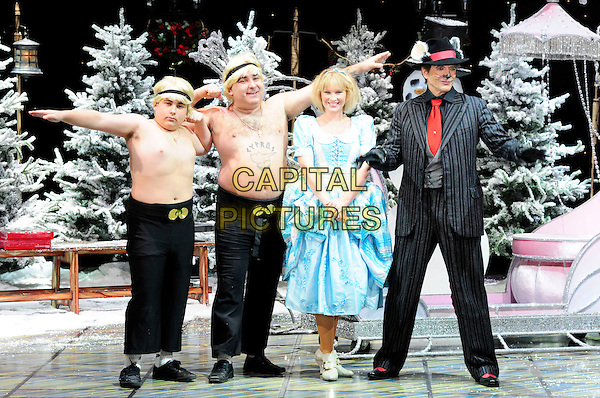JOANNA PAGE & DIRK BENEDICT.First Family Entertainment theatre company's annual group Pantomime photocall at Piccadilly Theatre, London, England..November 26th, 2010.stage costume panto pantomime full length blue dress black pinstripe suit hat red tie chests.CAP/CAS.©Bob Cass/Capital Pictures.