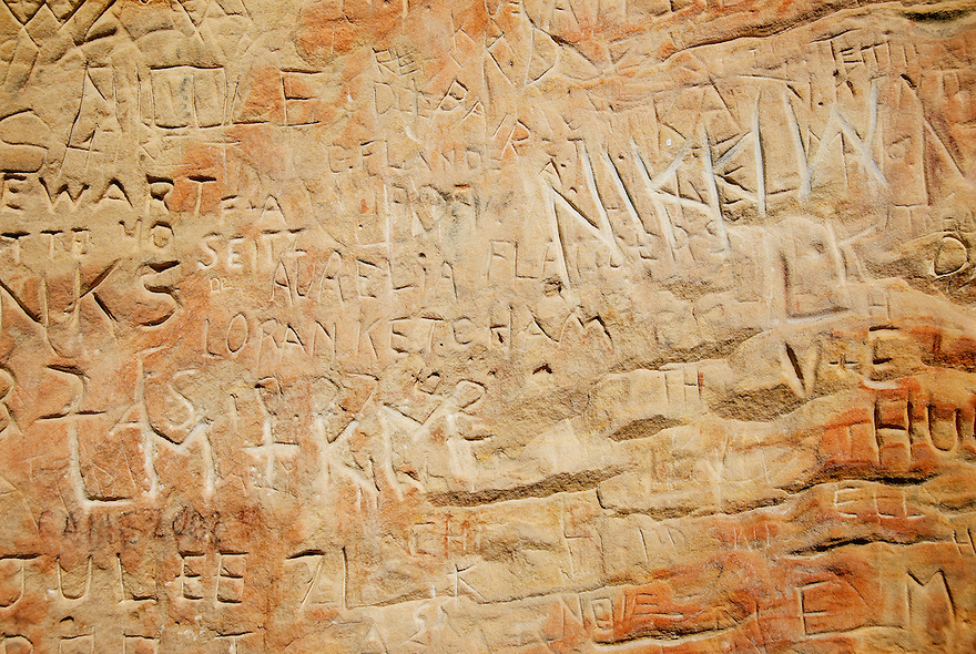 Names are seen carved in the soft limestone of History Rock in Hyalite Canyon south of Bozeman, Montana.