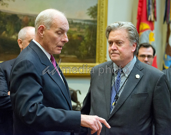 United States Secretary of Homeland Security John F. Kelly, left, speaks with Assistant to the President and Chief Strategist Steve Bannon, right, prior to the arrival of US President Donald Trump who will hold a listening session with cyber security experts in the in the Roosevelt Room of the White House in Washington, DC on Tuesday, January 31, 2017. Photo Credit: Ron Sachs/CNP/AdMedia