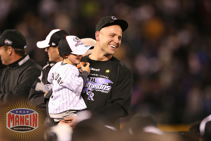 DENVER, CO - Matt Holliday of the Colorado Rockies celebrates after Game 4 of the National League Championship Series against the Arizona Diamondbacks at Coors Field in Denver, Colorado on October 15, 2007. The Rockies won the game and swept the series, clinching their first National League pennant. Photo by Brad Mangin