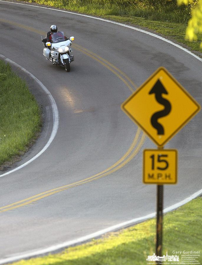 Charles Everitt drives a Honda Goldwing motorcycle Thursday, July 13, 2006 in Marysville, Ohio.