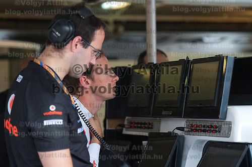 McLaren Formula One driver Jenson Button of Britain checks results on a screen after the free practice during the Hungarian F1 Grand Prix in Mogyorod (about 20km north-east from Budapest), Hungary. Thursday, 28. July 2011. ATTILA VOLGYI
