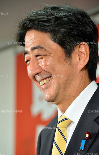 September 26, 2012, Tokyo, Japan - Japan's former Prime Minister Shinzo Abe, smiling broadly, poses for a battery of photographers before an inaugural news conference at the Liberal Democratic Party headquarters in Tokyo following his reelection as the LDP president on Wednesday, September 26, 2012..Abe has become the first LDP chief to make a comeback to the top post since the party was founded in 1955. Abe could also become Japan's prime minister for the second time , should the LDP oust the Democratic Party of Japan from power in the next general election to be held within a year. Abe became prime minister in September 2006 but quit the office after one short year because of his poor health. (Photo by Natsuki Sakai/AFLO)