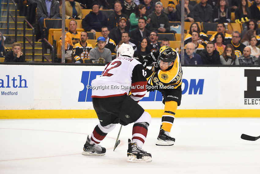 Tuesday, October 27, 2015: Boston Bruins left wing Brad Marchand (63) shoots the puck during the National Hockey League game between the Arizona Coyotes and the Boston Bruins held at TD Garden, in Boston, Massachusetts. The Coyotes lose to the Bruins 6-0 in regulation time. Eric Canha/CSM