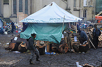 November 23, 2011, Toronto Police arrived in significant numbers deployed early this morning, beginning the process of evicting the Occupy Toronto tent camp from St. James Park.  Here midmorning, one unidentified protester boasts his soccer skills by the sacred fire tent.