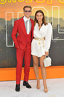 """LONDON, ENGLAND - JULY 30: Oliver Proudlock and Emma Louise Connolly at the """"Once Upon A Time In ... Hollywood"""" UK film premiere, Odeon Luxe Leicester Square, Leicester Square, on Tuesday 30 July 2019 in London, England, UK.<br /> CAP/CAN<br /> ©CAN/Capital Pictures"""