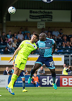 Adebayo Akinfenwa of Wycombe Wanderers and Luke Prosser of Colchester United during the Sky Bet League 2 match between Wycombe Wanderers and Colchester United at Adams Park, High Wycombe, England on 27 August 2016. Photo by Liam McAvoy.