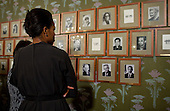 Oslo, Norway - December 10, 2009 -- First Lady Michelle Obama looks at pictures of past  Nobel Prize recipients at the Norwegian Nobel Institute in Oslo, Norway, Thursday, December 10, 2009. .Mandatory Credit: Pete Souza - White House via CNP
