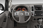 Car pictures of steering wheel view of a 2016 Nissan Frontier SV 4 Door Pick-up Steering Wheel