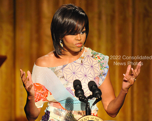 """Washington, D.C. - May 12, 2009 -- First Lady Michelle Obama  makes remarks as she and United States President Barack Obama host """"An Evening of Poetry, Music and the Spoken Word in the East Room of the White House in Washington, DC on Tuesday, May 12, 2009..Credit: Ron Sachs / Pool via CNP"""