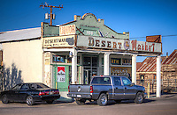 "The Desert Market has operated under a variety of proprietors since Daggett's early days, the original General Supply Store was destroyed in Daggett's 1908 fire. The store was rebuilt using a railroad carload of cement from the east, making the building the first fire-proof structure on the Mojave Desert. It was always a focal point for miners to convert gold dust into ""spendable"" currency. It is impossible to even estimate the total value of gold and silver which passed through this building. The store made history in 1953 when a safecracker obtained almost $1000 in gold dust and nuggets."