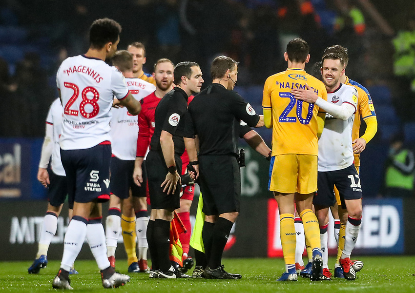 Players from both teams shake hands at the end of the match<br /> <br /> Photographer Andrew Kearns/CameraSport<br /> <br /> The EFL Sky Bet Championship - Bolton Wanderers v Wigan Athletic - Saturday 1st December 2018 - University of Bolton Stadium - Bolton<br /> <br /> World Copyright © 2018 CameraSport. All rights reserved. 43 Linden Ave. Countesthorpe. Leicester. England. LE8 5PG - Tel: +44 (0) 116 277 4147 - admin@camerasport.com - www.camerasport.com