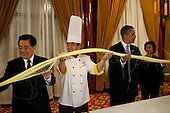 Beijing, China - November 16, 2009 -- United States President Barack Obama participates in a noodle making demonstration with President Hu Jintao of China, left, while attending a dinner at the Diaoyutai State Guest House in Beijing, China, Monday, November 16, 2009..Mandatory Credit: Pete Souza - White House via CNP