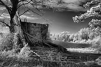 Infrared black/white barn near Cameron, NC, falling down next to a freshly plowed field