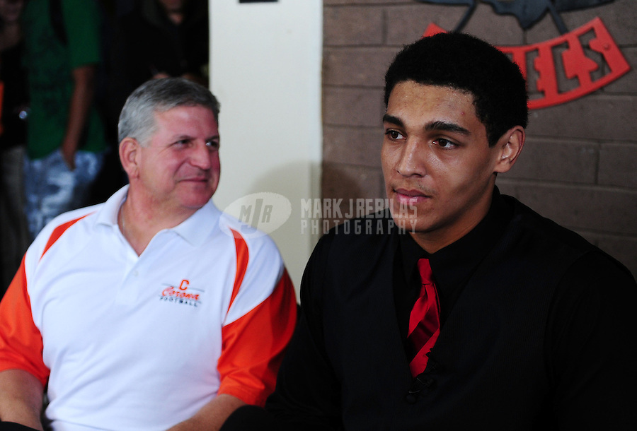 Feb. 1, 2012; Tempe AZ, USA; Corona del Sol Aztecs offensive lineman Andrus Peat (right) sits alongside head coach Tom Joseph at a press conference at Corona del Sol High School to announce his decision to play college football for the Stanford Cardinal. Mandatory Credit: Mark J. Rebilas-