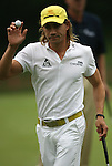 7 September 2008:    Camilo Villegas of Medellin, Colombia, South America waves to the crowd on the ninth hole in the delayed third round of play at the BMW Golf Championship at Bellerive Country Club in Town & Country, Missouri, a suburb of St. Louis, Missouri on Sunday September 7, 2008. He and 23 other golfers had to finish their third round of competition Sunday morning before the fourth and final round could be played due to the suspension of third round play because of darkness on Saturday Sept. 6.  The BMW Championship is the third event of the PGA's  Fed Ex Cup Tour.