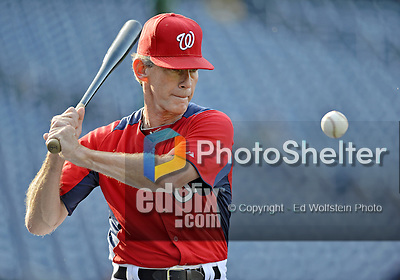 21 September 2012: Washington Nationals Bullpen Coach Jim Lett taps out infield grounders prior to a game against the Milwaukee Brewers at Nationals Park in Washington, DC. The Nationals fell to the Brewers 4-2 in the first game of their 4-game series. Mandatory Credit: Ed Wolfstein Photo