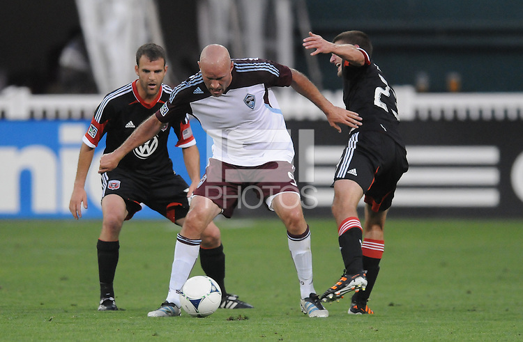 Colorado Rapids forward Conor Casey (9) goes against D.C. United midfielder Perry Kitchen (23) right and defender Daniel Woolard (21) left. D.C. United defeated the Colorado Rapids 2-0 at RFK Stadium, Wednesday May 16, 2012.