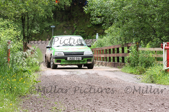 Tom Hynd - Sue Hynd in their Peugeot 205 GTi at Junction 7 on SS6 Ae West......