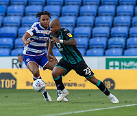 Reading's Liam Moore (left) battles with Swansea City's Andre Ayew (right) <br /> <br /> Photographer David Horton/CameraSport<br /> <br /> The EFL Sky Bet Championship - Reading v Swansea City - Wednesday July 22nd 2020 - Madejski Stadium - Reading <br /> <br /> World Copyright © 2020 CameraSport. All rights reserved. 43 Linden Ave. Countesthorpe. Leicester. England. LE8 5PG - Tel: +44 (0) 116 277 4147 - admin@camerasport.com - www.camerasport.com