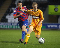 John McGinn watches Paul McCafferty closely in the St Mirren v Motherwell Clydesdale Bank Scottish Premier League U20 match played at St Mirren Park, Paisley on 10.9.12...