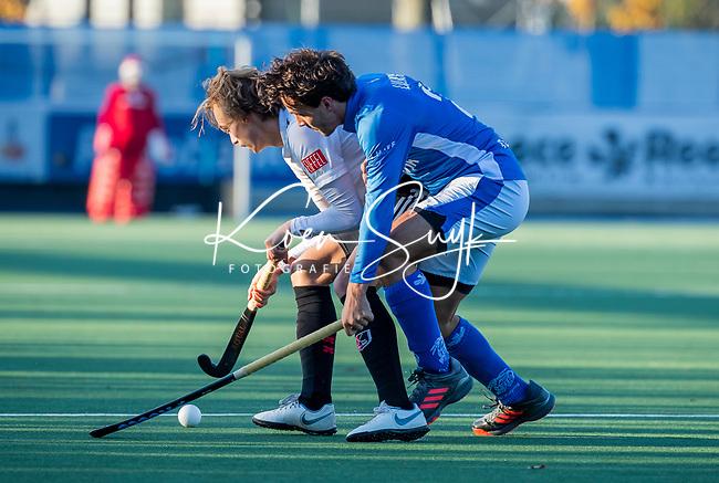 UTRECHT -   Floris Middendorp (Adam) met Pepijn Luijkx (Kampong) tijdens  de hoofdklasse hockeywedstrijd mannen, Kampong-Amsterdam (4-3).  COPYRIGHT KOEN SUYK