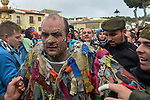 Raul Beites 34 gets dressed as Jarramplas to make his way through the streets beating his drum during the Jarramplas Festival on January 20, 2015 in Piornal, Spain. The centuries old Jarramplas festival takes place annually every January 19-20 on Saint Sebastian Day. Even though the exact origins of the festival are not known, various theories exist including the mythological punishment of Caco by Hercules, a relation to ceremonies celebrated by the American Indians that were seen by the first conquerors, to a cattle thief ridiculed and expelled by his village neighbours. It is generally believed to symbolize the expulsion of everything bad. This year the people who represented Jarramplas were Angel Cerro Fernandez on 19 January and Carlos Calle Rodríguez 47 and Raúl Beites Sánchez 34 on 20 January. (c) Pedro ARMESTRE