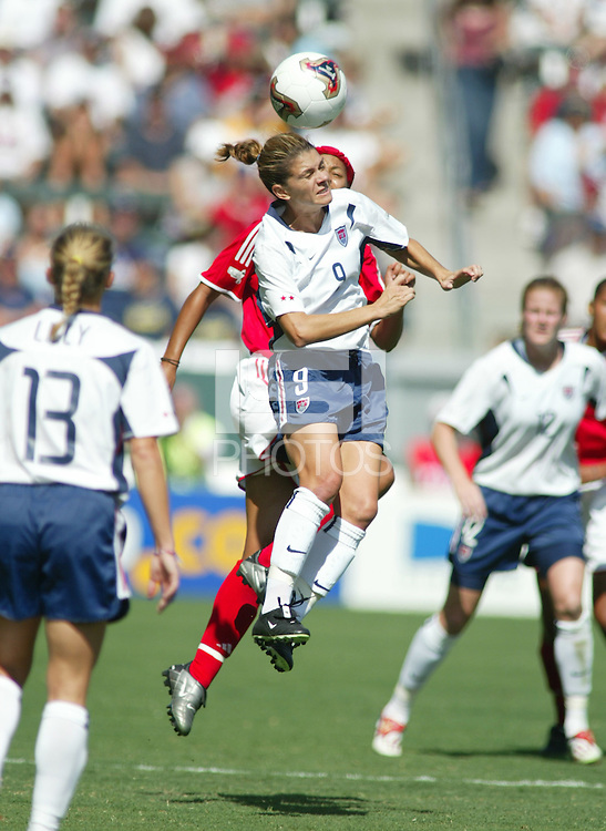 Mia Hamm (USA), Charmaine Hooper (Canada), United States vs. Canada in Carson, California on October 11th, 2003.  United States won 3-1 against Canada.