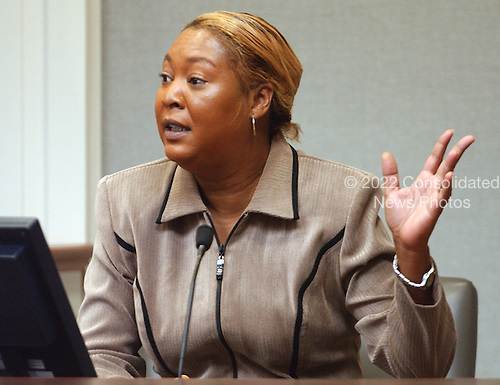 Prosecution witness Charlene Anderson, of Baton Rouge, Louisiana, gestures during testimony in the trial of sniper suspect John Allen Muhammad at the Virginia Beach Circuit Court in Virginia Beach, Virginia on November 13, 2003.  Anderson, cousin of sniper suspect John Allen Muhammad, was called as a rebuttal witness. <br /> Credit: Steve Earley - Pool via CNP