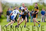 Seamus Brosnan Currow tries to brake away from Stan Divane and Kieran O'Callaghan Castleisland Desmonds during their Intermediate Championship clash in Castleisland on Sunday