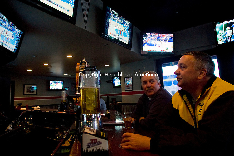 SOUTHINGTON, CT - 12 MARCH 2010 -031210JT02-<br /> John Buckridge, left, of Southington, talks to friend Bruce Bush of Bristol at the bar of TD Homer's Sports Bar in Southington on Friday. <br /> Josalee Thrift Republican-American
