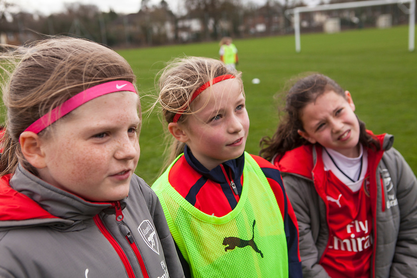 Left to right Rinini Lowe, Laila Harbert and Olivia Bartlett, all age 10. Arsenal Ladies Under 10 and AC Finchley boys team play a football game at Univeristy of Hertfordshire's campus sports village  football pitch in Hatfield.