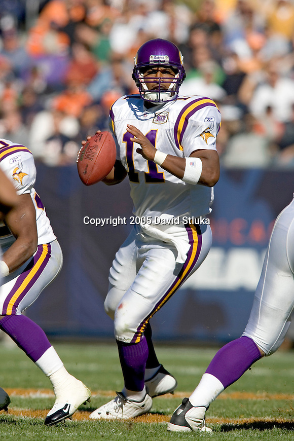 Quarterback Daunte Culpepper #11 of the Minnesota Vikings looks for a receiver against the Chicago Bears at Soldier Field on October 16, 2005 in Chicago, Illinois. The Bears defeated the Vikings 28-3. (Photo by David Stluka)