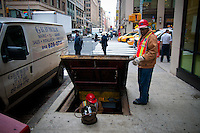 Workers get underground in Manhattan street, New York City