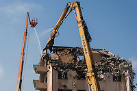 "A closer look at the equipment tearing down the old hospital building at the Eden Medical Center in Castro Valley, California.  At their website, Sutter Health refers to the process as deconstruction, ""because of the selective, targeted work involved and the recycling process—"""