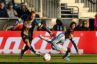 Fabio Alves (Fabinho) (33) of the Philadelphia Union and Graham Zusi (8) of Sporting Kansas City. Sporting Kansas City defeated the Philadelphia Union 2-1 during a Major League Soccer (MLS) match at PPL Park in Chester, PA, on October 26, 2013.