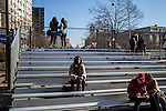 People sit on bleachers set up for viewing the Inaugural Parade on Sunday, January 20, 2013 in Washington, DC.