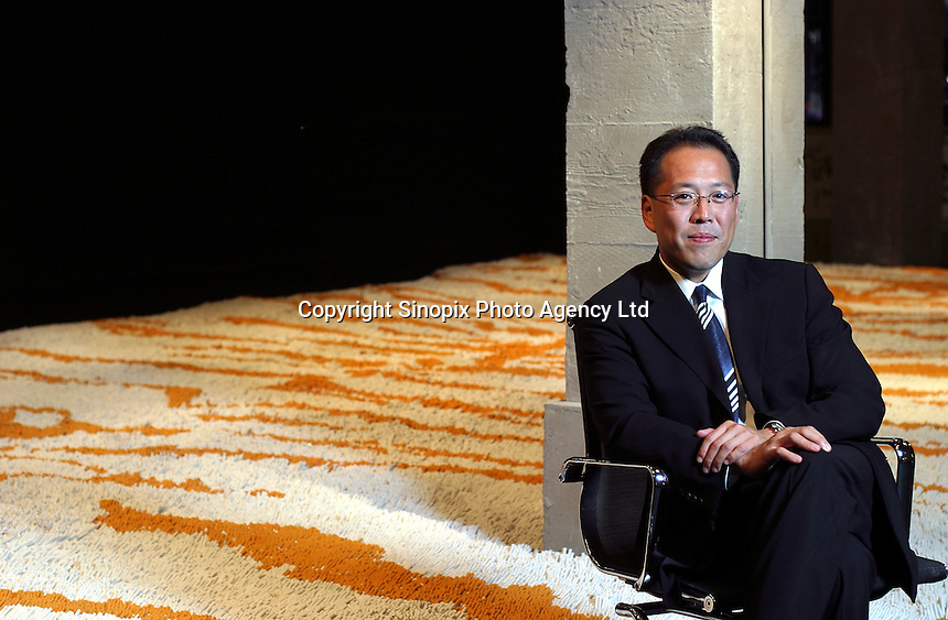 Handel Lee, Co-Chairman of Three On The Bund, poses for a picture in front of an installation art piece at his gallery in Shanghai. <br /> photo by Qilai Shen / Sinopix
