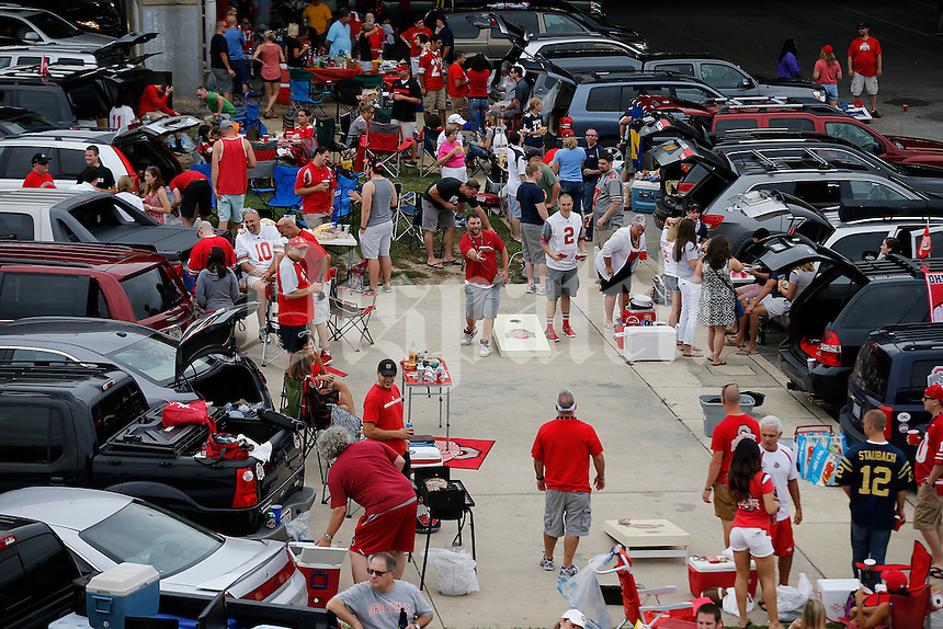 Ohio State Buckeye fans tailgate before the college football game between the Ohio State Buckeyes and the Navy Midshipmen at M&T Bank Stadium in Baltimore, Saturday morning, August 30, 2014. (The Columbus Dispatch / Eamon Queeney)