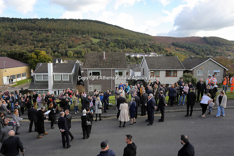 Pictured: Crowds greet Prince Charles at Hillside Close where Pantglas Junior School used to be in Aberfan Friday 21 October 2016<br />Re: Wales has fallen silent as the country remembered the Aberfan disaster 50 years ago.<br />On 21 October 1966, a mountain of coal waste slid down into a school and houses in the Welsh village, killing 144 people, including 116 children.<br />A day of events to commemorate the disaster included a service at Aberfan Cemetery at 9:15am on Friday.<br />Prince Charles is visiting Aberfan memorial garden before unveiling a plaque in memory of the victims.<br />He will also attend a reception with the families of some of those who lost their lives, before signing a book of remembrance.