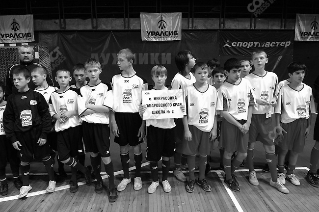 Schoolboys from a team from the Russian Far East stood at the award ceremony for a championship of mini-football, The Road of Champions, organised by the party United Russia, whose shirts they wore, in Moscow. November 23, 2007