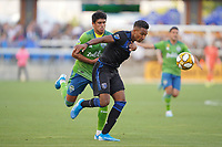 SAN JOSE, CA - SEPTEMBER 30: Danny Hoesen #9 of the San Jose Earthquakes and Xavier Arreaga #25 of the Seattle Sounders FC battle for the ball during a Major League Soccer (MLS) match between the San Jose Earthquakes and the Seattle Sounders on September 30, 2019 at Avaya Stadium in San Jose, California.