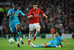 Manchester United's Cristiano Ronaldo tackled by Barcelona's Yaya Toure and Barcelona's Gianluca Zambrotta during the Champions League semi- final 2nd leg match at Old Trafford, Manchester. Picture date 29th April 2008. Picture credit should read: Simon Bellis/Sportimage