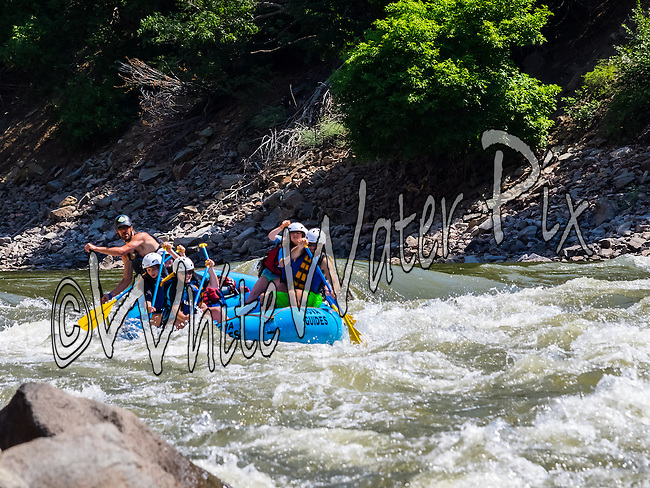Nova Guides crashing The Wall & Man-Eater Rapids while running Shoshone in Glenwood Canyon on the Colorado River on the morning of August 9, 2014.