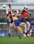Liam Markham of  Clare in action against Johnathan Flynn and Shay Millar of Down during their Division 2, Round 2 National League game at Cusack Park. Photograph by John Kelly.