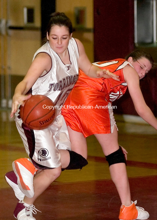 TORRINGTON, CT- 29 DECEMBER 2006-122906JS06- Torrington's Erika Murphy gets her knee twisted after colliding with Watertown's Kelly Blake during their NVL game at Torrington High School in Friday. <br /> Jim Shannon/Republican-American