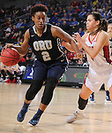 SIOUX FALLS, SD - MARCH 7:  Jordan Doyle #2 of Oral Roberts dribbles past Tia Hemiller #4 of South Dakota in 2016 Summit League Tournament play. (Photo by Dick Carlson/Inertia)